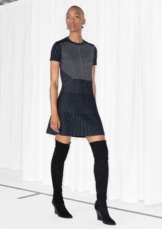 Fancy and ultra-comfy, this knitted dress features glittering stripes, short sleeves, and a long fit.