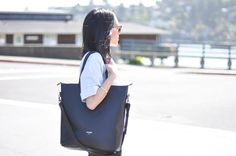 A Tote that looks professional, I can use for work/school, has a long handle to drape over my body as well.