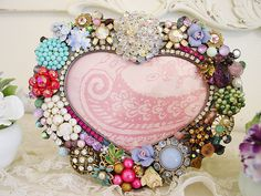 vintage jewelry embellished picture frame... love the glam and bling!------my grandma passed and I am using her costume jewelry to make a pic. frame for her sweet face!