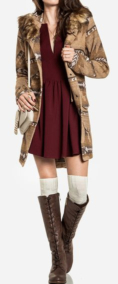 I like when the jacket and the dress are the same length!  The high boots are cool, too...