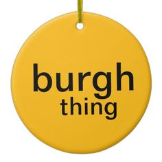 "Black and gold Christmas ornament, with ""burgh thing"""