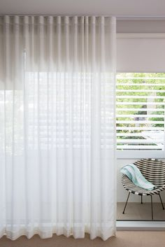 Stunning sheer white linen Curtains, overlaying sleek Helioscreen bloc-out Roller Blinds. Plantation Shutters finish the look on the balcony rail. Powder-coated aluminium, these Plantation Shutters are weather proof and never need repainting.  Three in one combo.  All available from Shakespeare Design.   Contact at enquiries@shakespeare-design.com.au for more information or http://shakespeare-design.com.au/services-1/curtains-blinds-shutters-awnings/#prettyPhoto