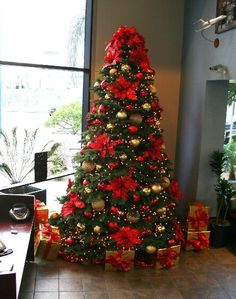 Traditional red and gold Christmas decorations for commercial spaces by the professional Christmas decorators at the Christmas Specialists. Elegant Christmas Trees, Red And Gold Christmas Tree, Gold Christmas Decorations, Ribbon On Christmas Tree, Christmas Tree Themes, Xmas Tree, Simple Christmas, Christmas Christmas, Christmas Tree Poinsettia
