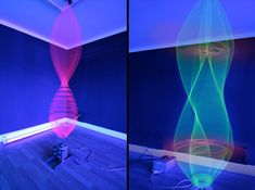 An installation with phosphorescent fabric and light beams