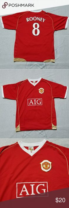Wayne Rooney Jersey The jersey is a  throwback from when Rooney played for Manchester United. It red with white lettering and gold pin stripes up the sides. Jersey is used but still in good condition.  Has small stain on then collar which is shown in the picture. Not really noticeable unless your looking for it.  Size L. Shirts Tees - Short Sleeve