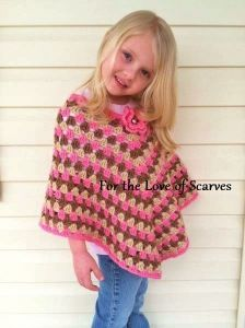Girl's crochet poncho...I kmow a little girl who would look so cute in this :)