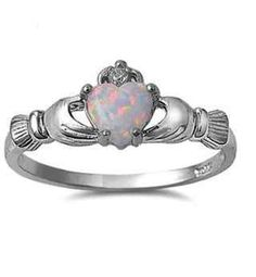 Irish Celtic Claddagh CLADDAUGH Ring Handcrafted 925 Sterling Silver w/ White Opal Heart and Clear CZ The Irish Claddagh symbolizes Love, Loyalty and Friendship The Claddaghs distinctive design Silver Claddagh Ring, Claddagh Rings, Claddagh Symbol, Bling Bling, Traditional Wedding Rings, Opal Birthstone, White Opal Ring, Celtic Wedding Rings, Opal Rings