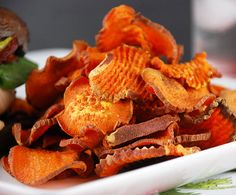 Baked sweet potato chips - 3 ingredients:  sweet potatoes, olive oil and sea salt...for when you gotta have that crunch!  Multiply Delicious sweetpota_chips