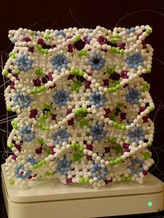Beaded gyroidal graphitic structure. This whole blog is awesome - it's all sciencey structures done in beadwork.