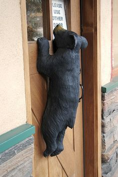 (rustic) bear outside looking in....