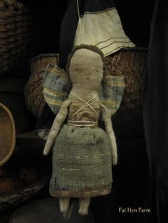 """This sweet angel is made from a wonderful early quilt. Her body is made from old feedsack cloth and I've stuffed her with old cotton. I've stitched her completely by hand and she is signed and dated. She is wonderfully simple and crude!  Approx. 9"""" tall. $59 ~includes US priority shipping"""