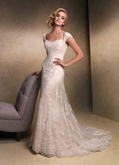 Chic and gorgeous, elegant lace with a sheer layer and beaded cathedral style train that sparkles as you walk, this is an elegant and classy look for the vintage bride
