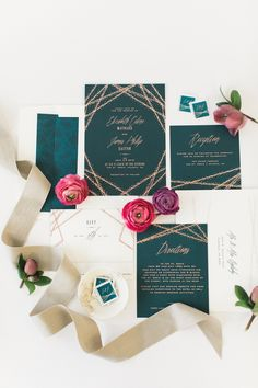 Glitzy lines seemed to glitter from the page on this deep-green wedding invitation set.