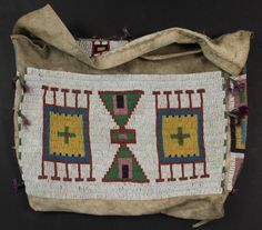 Lakota Beaded Buffalo Hide Possible Bag, last quarter of c., the front, flap and sides. tin cone danglers with purple feathers, x Native Beadwork, Native American Beadwork, Native American Beauty, Native American History, Medicine Bag, Native American Artifacts, Beaded Bags, Native Art, Leather Pouch