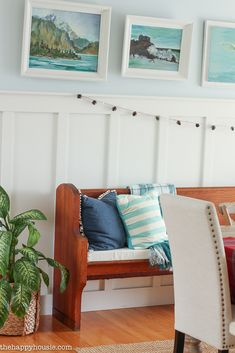Blue and aqua cottage Lake house decor with retro seaside art and wainscoting