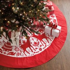 The whimsical holiday motif of our Yuletide Embroidered Tree Skirt was inspired by the traditional Otomi textiles of Mexico. Reindeer, turtledoves and classic Christmas symbols are accented with fine embroidery for rich texture.