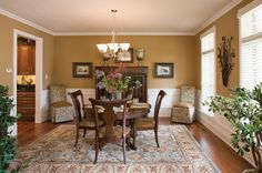 Dining room with hardwood floors and easy access to wine rack in kitcen