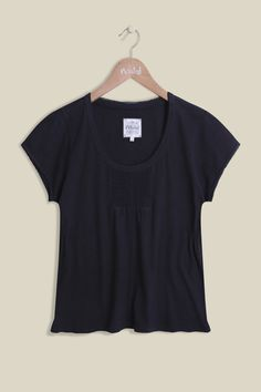 Our Day Dreamer Tee is 100% cotton making it super-soft and lightweight, perfect for the upcoming seasons. The far from basic tee offers stirring detail on the chest and an elegant lace hem along the rounded neckline. Perfectly paired with one of our cardigans and jeans. Also available in Blush and Blue Glow.