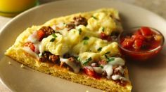 Turn the classic Mexican egg dish into a delicious pizza, using Bisquick® Gluten Free mix and Old El Paso® salsa.