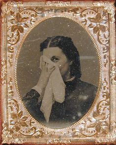 ca. 1860's, tintype portrait of a woman smiling coyly from behind a handkerchief, S. Shattuc