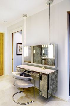 Medicine cabinet–style mirrors above the dressing table provide storage and give this dressing table a built-in look.