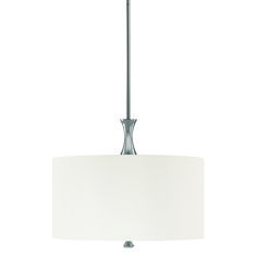 Our Studio 4-light pendant brightens modern kitchens with sleek style, thanks to the crisp, decorative white fabric shade and shining Polished Nickel finish. It creates a focal point over an island or dining table, illuminating the room with a fresh design touch.