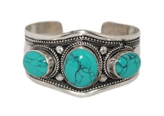 This is a one size adjustable Cuff Bracelet handcrafted by local artisan from Kathmandu, Nepal. ➢ Metal : => White metal ➢ Stone : => Turquoise ➢ The bracelet front height: = 38mm