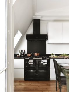 An AGA stove makes a beautiful statement in a kitchen from A+B Kasha.