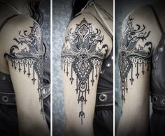 I am more and more enamored with this style: shoulder piece with a trailing design. This would look nice opening up into a hamsa hand at the top.