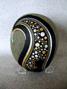 Painted Galaxy Design Rock, Black, Gold and Silver Stars via Etsy.