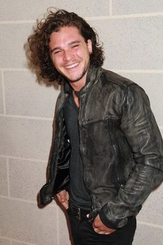 See? Kit Harington DOES smile! (And looks very cute when he does.)