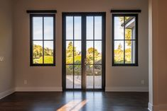 French doors with sidelights connect the kitchen to the back patio area.
