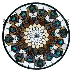 Handcrafted Tiffany-style stained glass window with a peacock feather motif.  Product: WindowConstruction Material: Glass