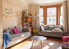 Emily & Stef's Creative, Colorful London Home. I love the little surprise yellow table.
