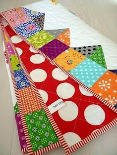 LOVE the backing!!!  Cute quilt edging idea.