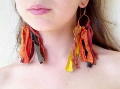 These long earrings have bohemian dreamcatcher design. Another pair of beautiful Indian silk tassels, featuring gorgeous subtle earth tones of orange, yellow, green and dark red silk. They are wire wrapped with copper wire and hanging from copper hoops. An accessory must have for the free spirited Bohemian, and just in time for festivals! Super light weight.  Diameter 4.7 inches / 12 cm  * These earrings are made to order handcrafted and shipped by me, so may take 3 - 5 working days befo...