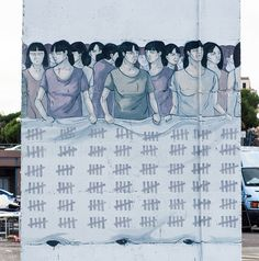 Hyuro has painted the powerful image of a group of women holding a large sheet with tallies on it. The image was painted by the Spanish artist to rais...