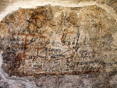 What Does First-century Roman Graffiti Say? Work at Rome's Colosseum turns up 2,000-year-old scrawling. Ancient graffiti (in red) is covered by tourists' markings inside Rome's Colosseum.