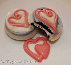 Candy coated oreos.  (just had this from our local cupcake shop, Bliss - they were delicious - couldn't see the oreo through like this picture).  Had milk chocolate and white chocolate.  Easy to tell they just used a thick mold.