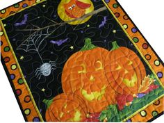 Quilted Jack-o-Lanterns Wall Hanging. $35.00, via Etsy.