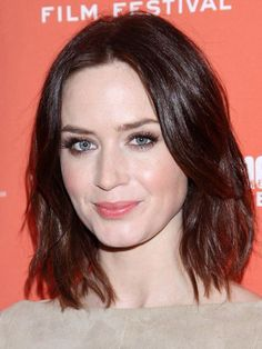 Emily Blunt's choppy A-line bob hairstyle, pink lips and rosy glow | allure.com