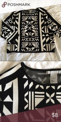 Patterned Cropped Sweater A size L cropped sweater that fits me (I usually wear small) without looking like it's too cropped. Cool black and white design really stands out. Excellent used condition. 42%  Rayon, 40% Acrylic, 18% Nylon. H&M Sweaters