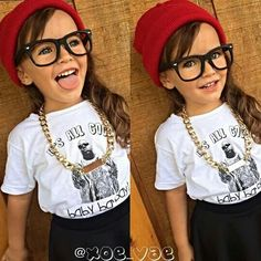 I'm loving this awesome tee from #littokiddo! Xoe is lookin' extra fly with that gold chain, red beanie and her cute glasses.