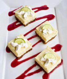 Key Lime Cheesecake Bars with Raspberry Sauce   Yummy Noises Key Lime Cheesecake Bars, Sweet Condensed Milk, Best Key Lime Pie, Key Lime Juice, Refreshing Desserts, Raspberry Sauce, Stick Of Butter, Dessert Bars, Graham Crackers