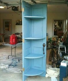 Turn an OLD DOOR into a CORNER SHELF....this is such a great idea! What do you think? Featured on our Best Upcycled ideas!  http://kitchenfunwithmy3sons.com/2016/04/best-upcycled-furniture-ideas.html/
