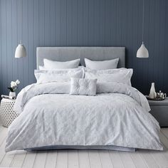 A beautiful woven jacquard quilt cover with contrast faux silk base cloth in a soft blue baroque design. Coordinating european and matching standard pillowcases complete an elegant look from Mercer + Reid.