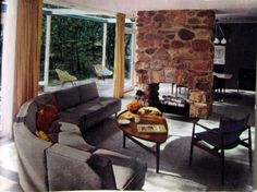 alwaysalwaysalwaysthesea:    1955 living room with room-dividing stone fireplace, from the September 1955 Women's Home Companion.  (more on my blog)    Love this room!