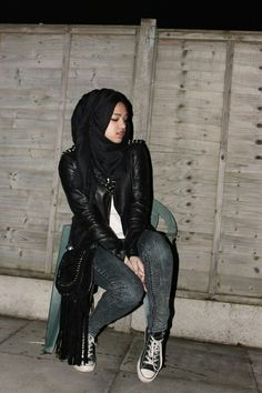 Pretty girl in leather and jeans