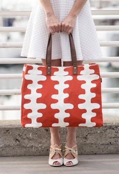 """Echo Tangerine Carryall Tote 12"""" x 16"""" x 4"""" Printed on recycled canvas with eco-friendly pigment inks. Our canvas totes are soft yet durable, and an easy carr"""