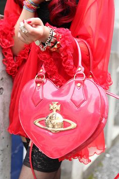Pink heart bag. Also, the whole look.